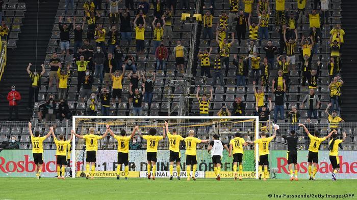 Borussia Dortmund's players celebrate after a win