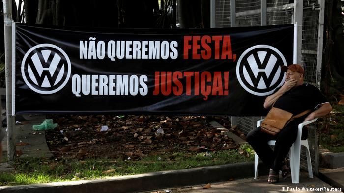 Former Volkswagen worker Raimundo Nonato sits in front of VW factory headquarters during a protest against the presentation of the study of Volkswagen's role in Brazil from 1964 to 1985,