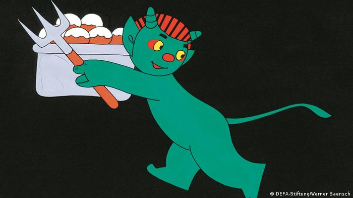 Film still Sounding alarm at the Puppet Theater, cartoon of a teal-colored devil carrying a pitchfork and a box (DEFA-Stiftung/Werner Baensch)
