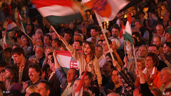 Supporters of Fidesz, Hungary's center-right Fidesz party react to the preliminary official results in Budapest