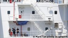 LONG BEACH, CALIFORNIA - MAY 01: Crew members stand aboard the crude oil tanker Aristaios, anchored near the ports of Long Beach and Los Angeles, as viewed from a United States Coast Guard patrol boat amid the coronavirus pandemic on May 1, 2020 off the coast of Long Beach, California. Around three dozen oil tankers are currently anchored off the coast of California as the spread of COVID-19 impacts global demand for crude oil. Mario Tama/Getty Images/AFP