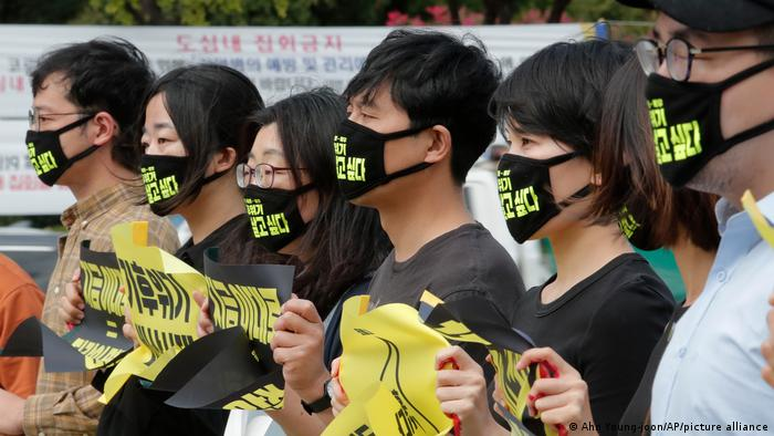 Protesters wearing face masks to protect themselves from coronavirus infection