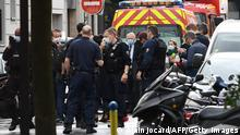 Paris prosecutor Remy Heitz (C), surrounded by police, visits the scene after several people were injured near the former offices of the French satirical magazine Charlie Hebdo following an attack by a man wielding a knife in the capital Paris on September 25, 2020. - Four people were injured, two seriously, in a knife attack in Paris on September 25, 2020, near the former offices of French satirical magazine Charlie Hebdo, a source close to the investigation told AFP. Two of the victims were in a critical condition, the Paris police department said, adding two suspects were on the run. The stabbing came as a trial was underway in the capital for alleged accomplices of the authors of the January 2015 attack on the Charlie Hebdo weekly that claimed 12 lives. (Photo by Alain JOCARD / AFP) (Photo by ALAIN JOCARD/AFP via Getty Images)
