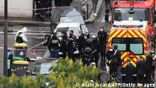Police in Paris cordon off the scene of the knife attack