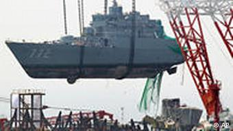 a giant offshore crane salvages the bow section of the South Korean naval ship Cheonan off Baengnyeong Island, South Korea. Investigators in Seoul say they have proof that North Korea fired a torpedo that sank a South Korean warship.