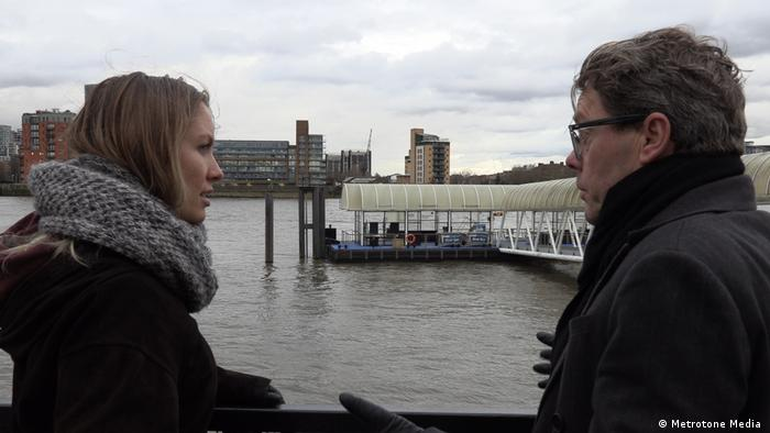 Two journalists, Katharina Gellein and Charles Kriel, standing at a lake