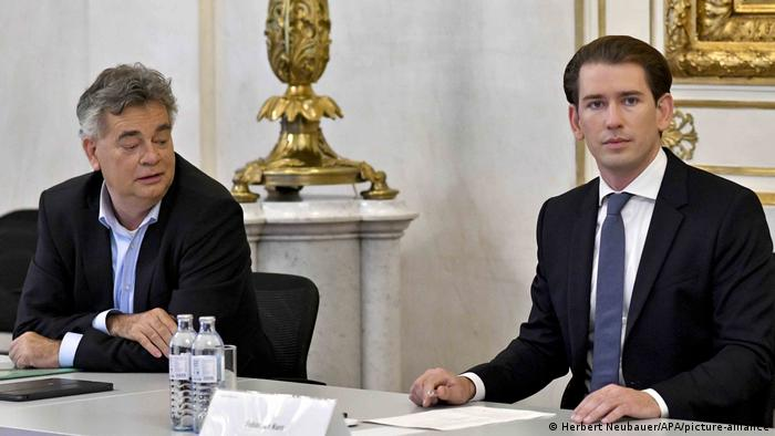 Werner Kogler sitting next to then chancellor Sebastian Kurz