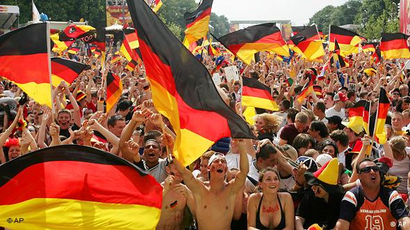 Lots of soccer fans waving German flags in Berlin during the 2006 World Cup (AP)
