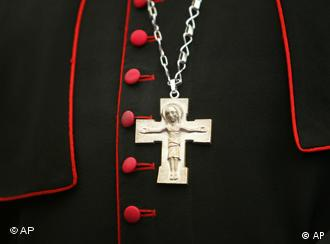 A crucifix hangs from a priest's neck