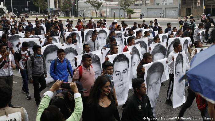 College students and family members of 43 missing students take part in a protest in Mexico
