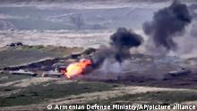 An Azerbaijan military vehicle on fire (Armenian Defense Ministry/AP/picture alliance)