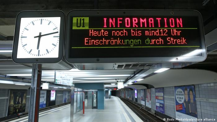 a sign at a train station saying no trains are running until midday