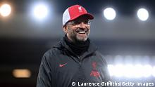 Liverpool's German manager Jurgen Klopp speaks during a television interview after the English Premier League football match between Liverpool and Arsenal at Anfield in Liverpool, north west England on September 28, 2020. (Photo by Laurence Griffiths / POOL / AFP) / RESTRICTED TO EDITORIAL USE. No use with unauthorized audio, video, data, fixture lists, club/league logos or 'live' services. Online in-match use limited to 120 images. An additional 40 images may be used in extra time. No video emulation. Social media in-match use limited to 120 images. An additional 40 images may be used in extra time. No use in betting publications, games or single club/league/player publications. / (Photo by LAURENCE GRIFFITHS/POOL/AFP via Getty Images)