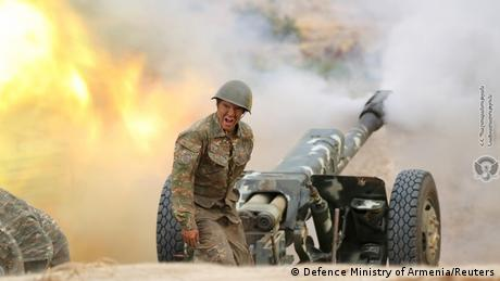 An ethnic Armenian soldier fires an artillery piece during fighting with Azerbaijan's forces