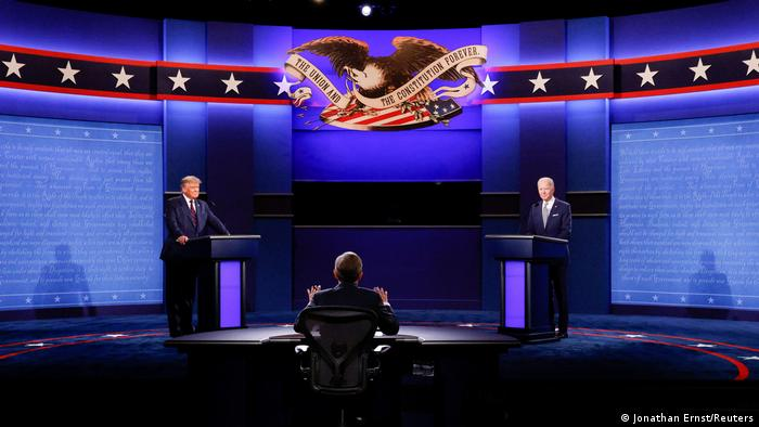 US President Donald Trump and Democratic presidential nominee Joe Biden on stage at the first 2020 US general election debate in Cleveland, Ohio