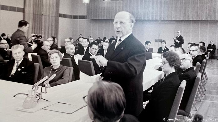 An archive picter of former East German communist leader Walter Ulbricht lecturing a group of business owners on the benefits of state ownership.