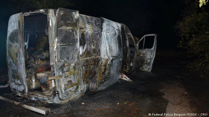 A burnt-out van