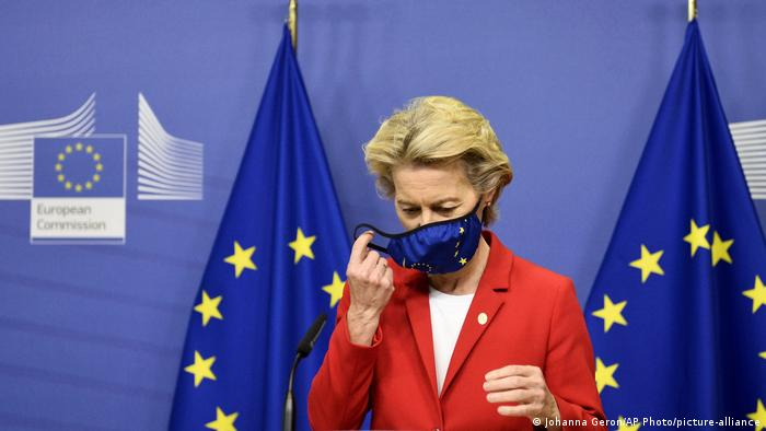 European Commission President Ursula von der Leyen, takes off her protective mask