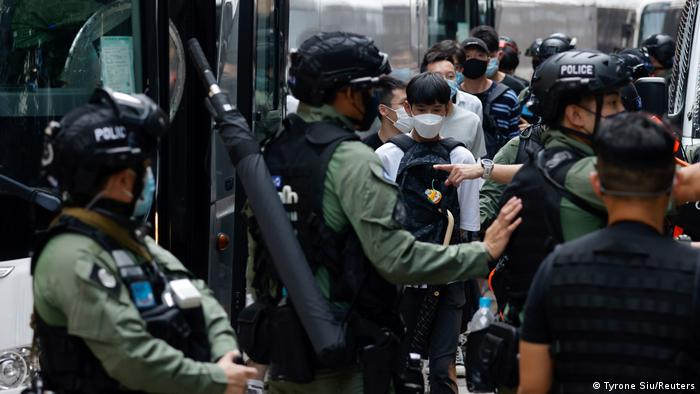 Hong Kong protesters are detained by police