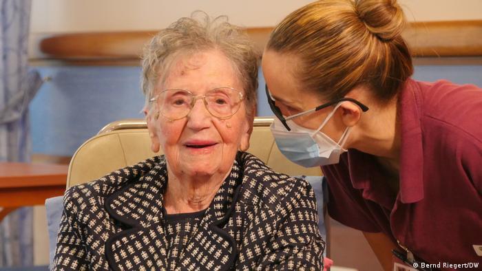 Fatima Negrini and a nurse wearing a face mask