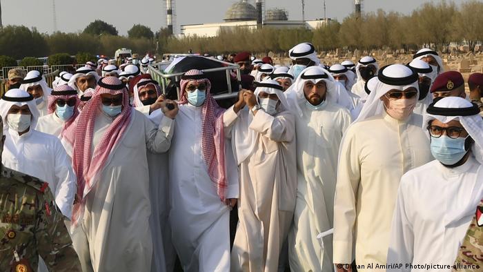 Men carrying coffin of Sabah Al Ahmad Al Sabah