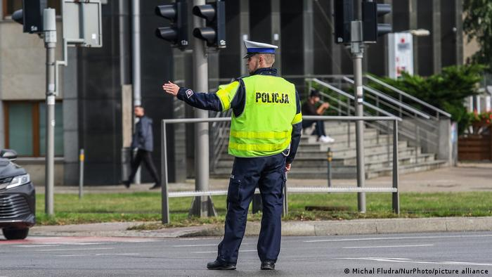 A Polish police officer facing away from the camera