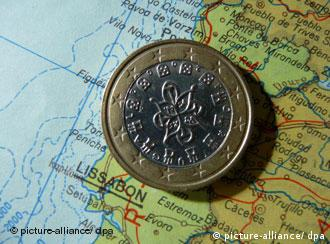 A euro coin on a map of Portugal