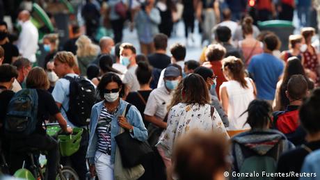 People walking on a crowded street in Paris