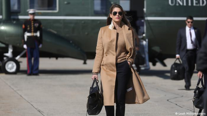 Hope Hicks in front of helicopter