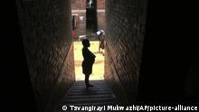 A pregnant woman waits in a passageway, waiting for her turn to deliver her baby, in a tiny apartment in the poor surburb of Mbare in Harare, Zimbabwe, in this Saturday, Nov. 16, 2019, with the help of 72-year old grandmother Esther Zinyoro Gwena. Grandmother Esther Zinyoro Gwena claims to be guided by the holy spirit and has become a local hero, as the country's economic crisis forces closure of medical facilities, and mothers-to-be seek out untrained birth attendants.(AP Photo/Tsvangirayi Mukwazhi) |