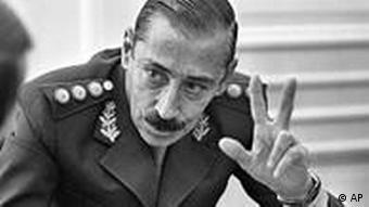 ** FILE ** Former military President Gen. Jorge Rafael Videla is seen in this June 1978, file photo. A federal court threw out amnesties Wednesday for former Gen. Videla and former Navy chief Eduardo Massera, leading members of the 1976-1983 military junta, saying they must serve their life terms in prison for crimes against humanity. The military junta waged a dirty war against political opponents, seizing and killing about 9,000 people, according to official records. Human rights groups put the death toll closer to 30,000. (AP Photo/Eduardo Di Baia)