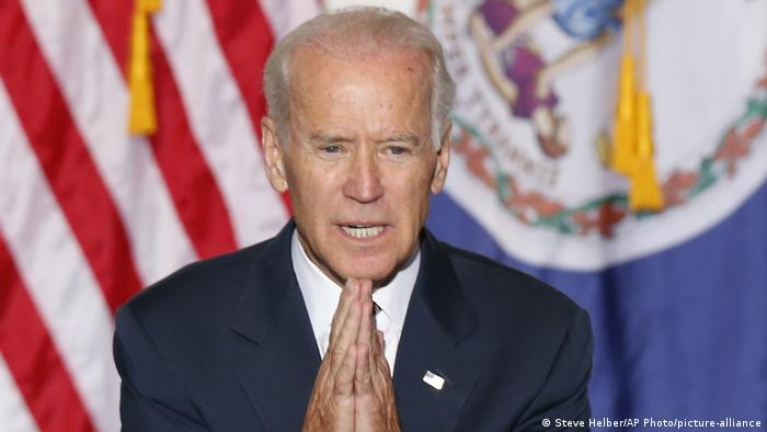Joe Biden gestures during a speech