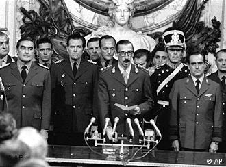 Gen. Jorge Rafael Videla, center, is sworn-in as President at the Buenos Aires Government House on March 24, 1976 accompanied by Adm. Emilio Massera, left, and Brig. Orlando Agosti, right, members of the junta that overthrew President Isabel Peron. During the dictatorship's so-called Dirty War, the armed forces waged a campaign against leftist and other political opponents that left at least 9,000 poeple killed or disappeared, by the government's count. Human rights groups put the figure closer to 30,000. The extent of abuses was made public after Argentina returned to democracy in 1983. (AP Photo)