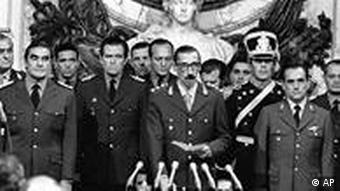 Gen. Jorge Rafael Videla (C) is sworn-in as President at the Buenos Aires Government House on March 24, 1976