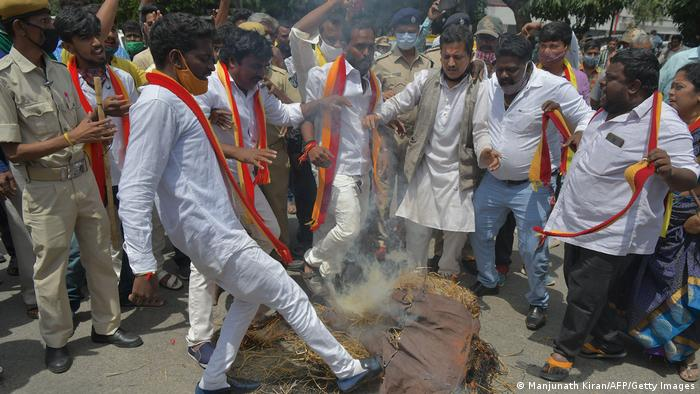 Activists belonging to various farmers rights organisations burn the effigy of Karnataka Chief Minister B. S. Yediyurappa during an anti-government demonstration to protest against the recent passing of new farm bills in parliament, in Bangalore on September 28, 2020