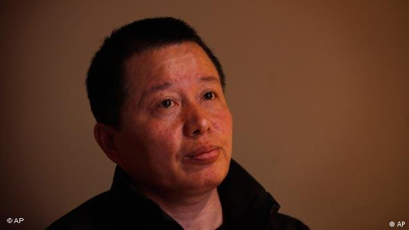 Gao Zhisheng, a human rights lawyer, pays attention to a question during his first meeting with the media since he resurfaced two weeks ago, at a tea house in Beijing, China, Wednesday, April 7, 2010. Gao, whose disappearance more than a year ago caused an international outcry, said Wednesday that he is abandoning his once prominent role as a government critic in hopes of reuniting with his family. In the meeting, Gao said he did not want to discuss his disappearance. (AP Photo/Gemunu Amarasinghe)