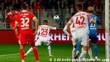 Union Berlin's German forward Max Kruse (L) heads the ball to score the 1-0 during the German first division Bundesliga football match 1 FC Union Berlin v 1 FSV Mainz 05 on October 2, 2020 in Berlin, Germany. (Photo by Odd ANDERSEN / AFP) / DFL REGULATIONS PROHIBIT ANY USE OF PHOTOGRAPHS AS IMAGE SEQUENCES AND/OR QUASI-VIDEO (Photo by ODD ANDERSEN/AFP via Getty Images)