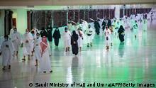 04.10.2020 A handout picture provided by the Saudi Ministry of Hajj and Umrah on October 4, 2020, shows Saudis and foreign residents arriving to perform Umrah in the Grand Mosque complex in the holy city of Mecca, as authorities partially resume the year-round pilgrimage amid extensive health precautions after a seven-month coronavirus hiatus. (Photo by - / Saudi Ministry of Hajj and Umra / AFP) (Photo by -/Saudi Ministry of Hajj and Umra/AFP via Getty Images)