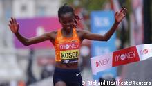 October 4, 2020** Athletics - London Marathon - London, Britain - October 4, 2020 Kenya's Brigid Kosgei celebrates as she wins the elite women's race of the London Marathon Pool via REUTERS/Richard Heathcote