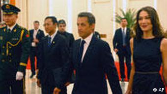 Sarkozy and his wife arriving at a dinner party in Beijing