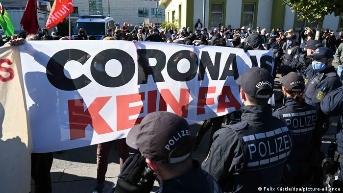 Coutner-protesters stand with banner in front of police