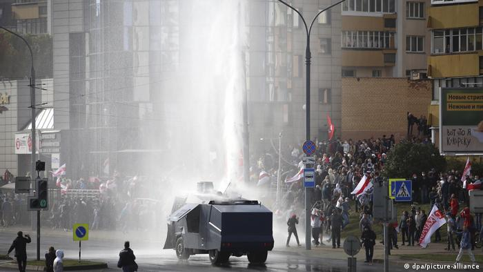 Police fire a water cannon at protesters in Minsk.