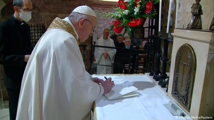 Pope Francis signing his Fratelli Tutti encyclical on October 3