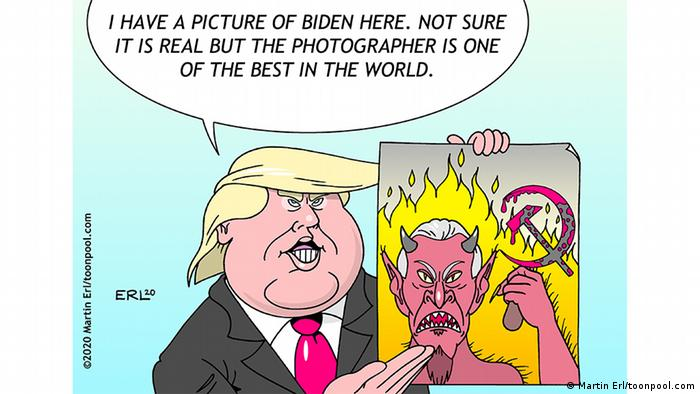 Donald Trump holds up a picture of Joe Biden depicted as a horned devil with a hammer and sickle with flames burning in the background (caricature by Martin Erl/toonpool.com)