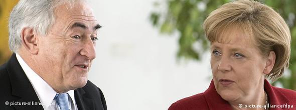 Chancellor Angela Merkel and the IMF's Dominique Strauss-Kahn
