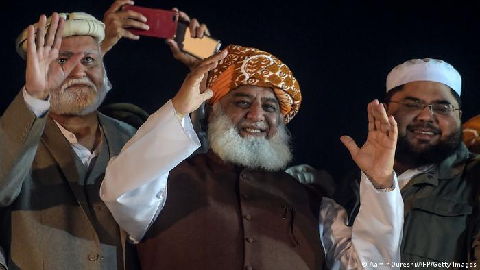 Maulana Fazlur Rehman hold up his hands