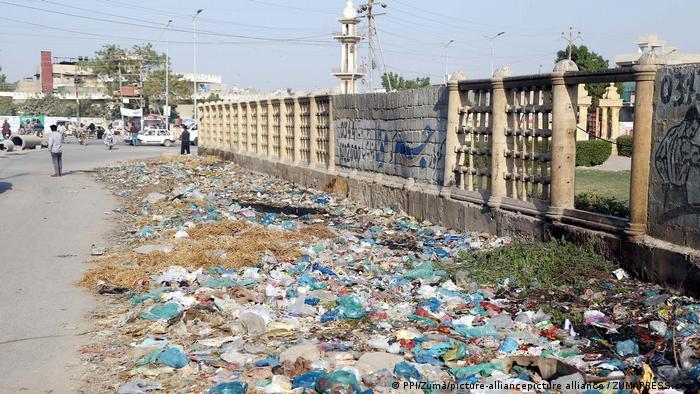 Trash piles in Karachi slum