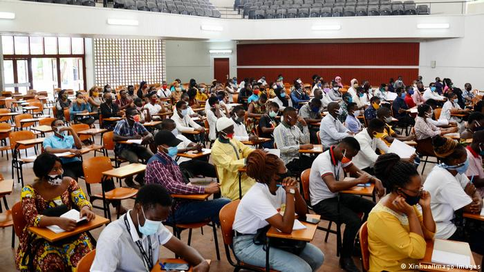 Students sit at desks in a lecture at the University of Dar es Salaam in Tanzania