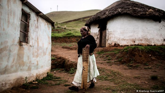A South African woman walks through the a village in rural KwaZulu Natal (Gianluigi Guerica/AFP)