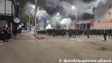 05.10.2020, Kirgistan, Bischkek: 6349673 05.10.2020 In this video grab, law enforcement officers run through the smoke during a rally against the parliamentary elections results, in Bishkek, Kyrgyzstan. Sputnik Foto: Sputnik |